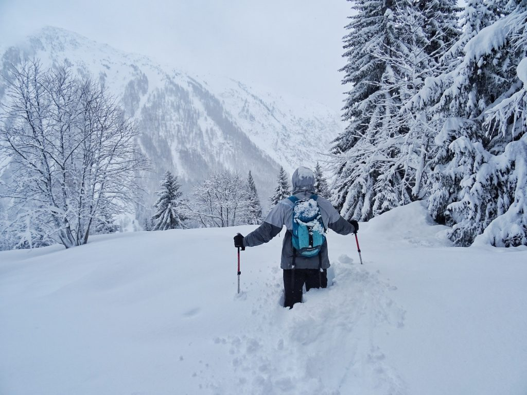 Man hiking in the snowy mountains, French Alps