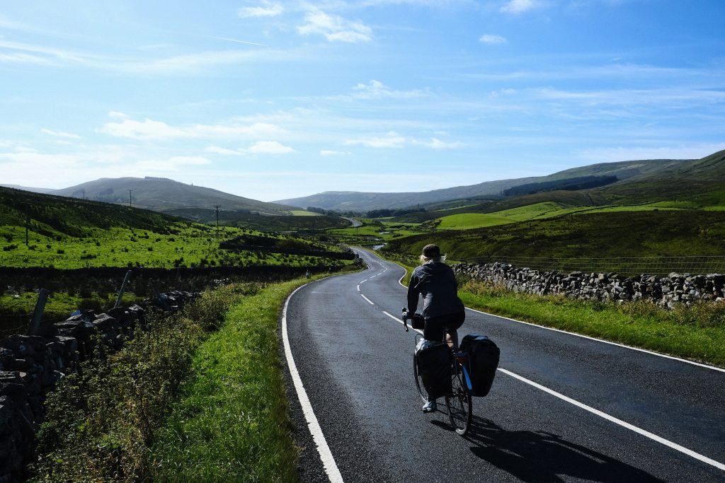 Girl cycling along the Dales Cycleway