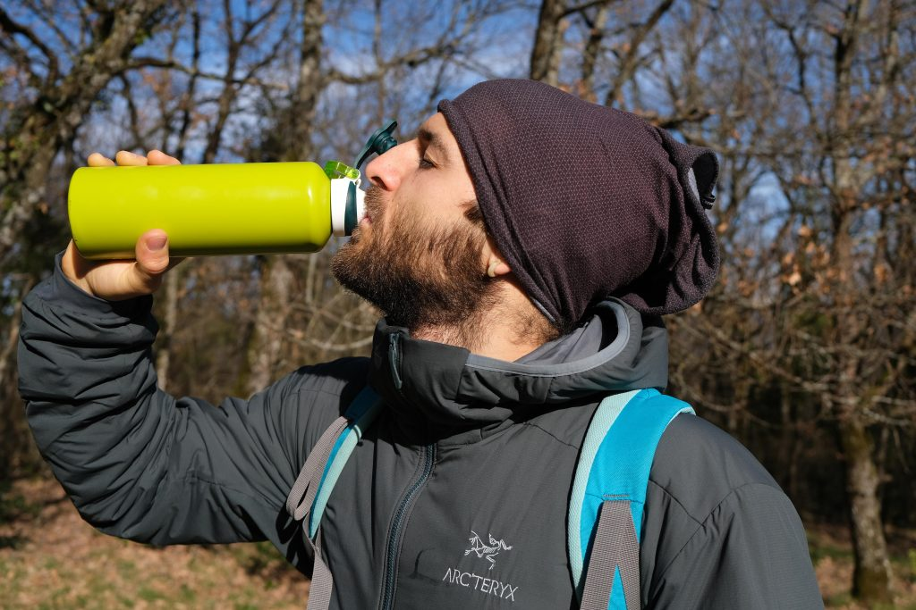 Man wearing vegan coat in woods