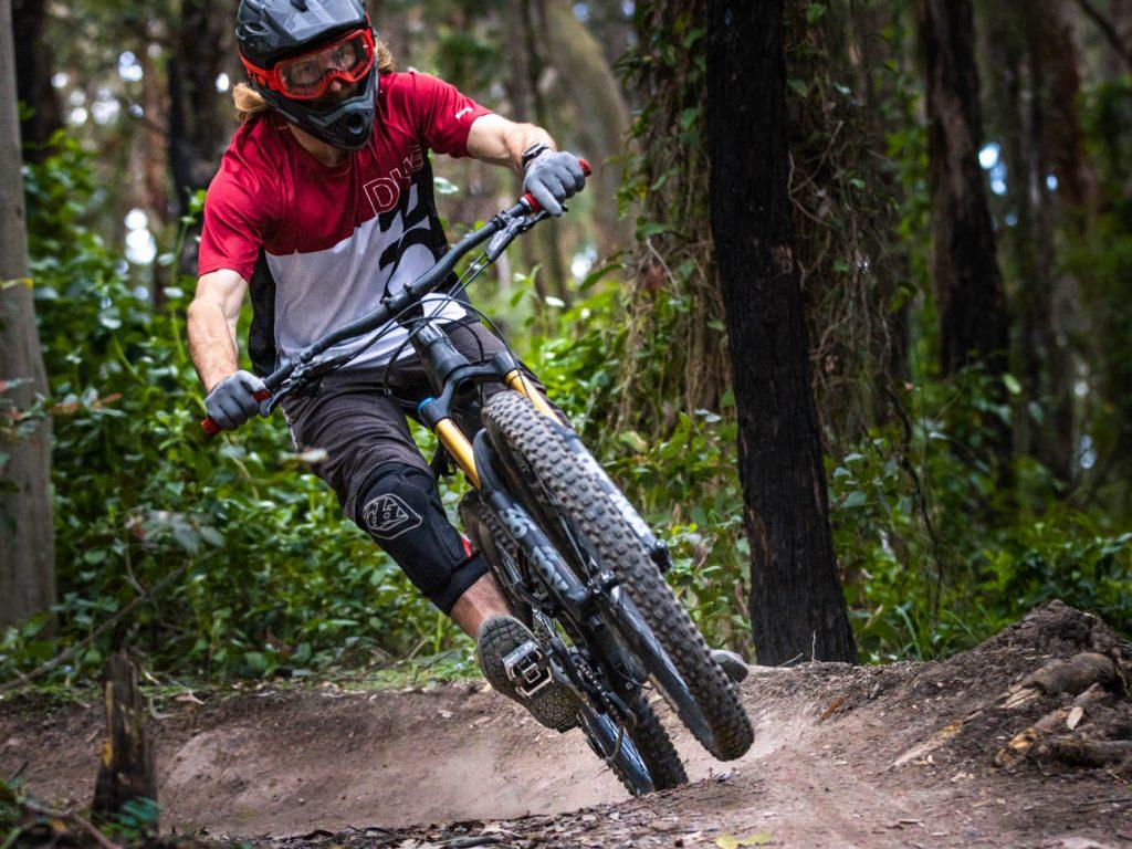 Female mountain biker on dirt track