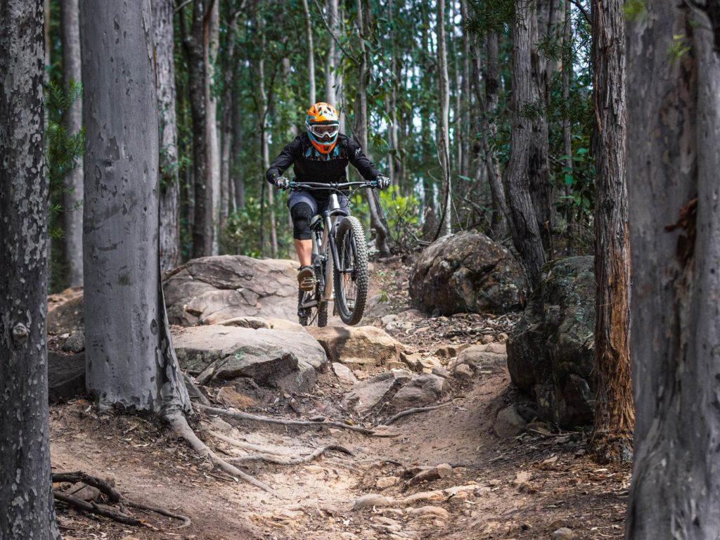 Mountain biking through the woods