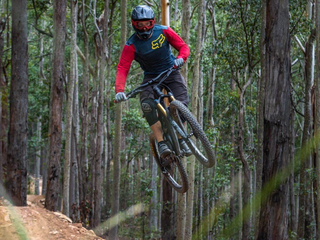 Mountain biker in air from dirt jump