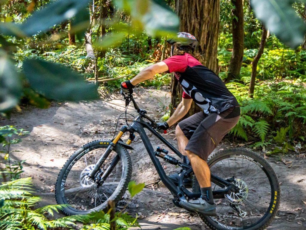beginner mountain biker turning a corner