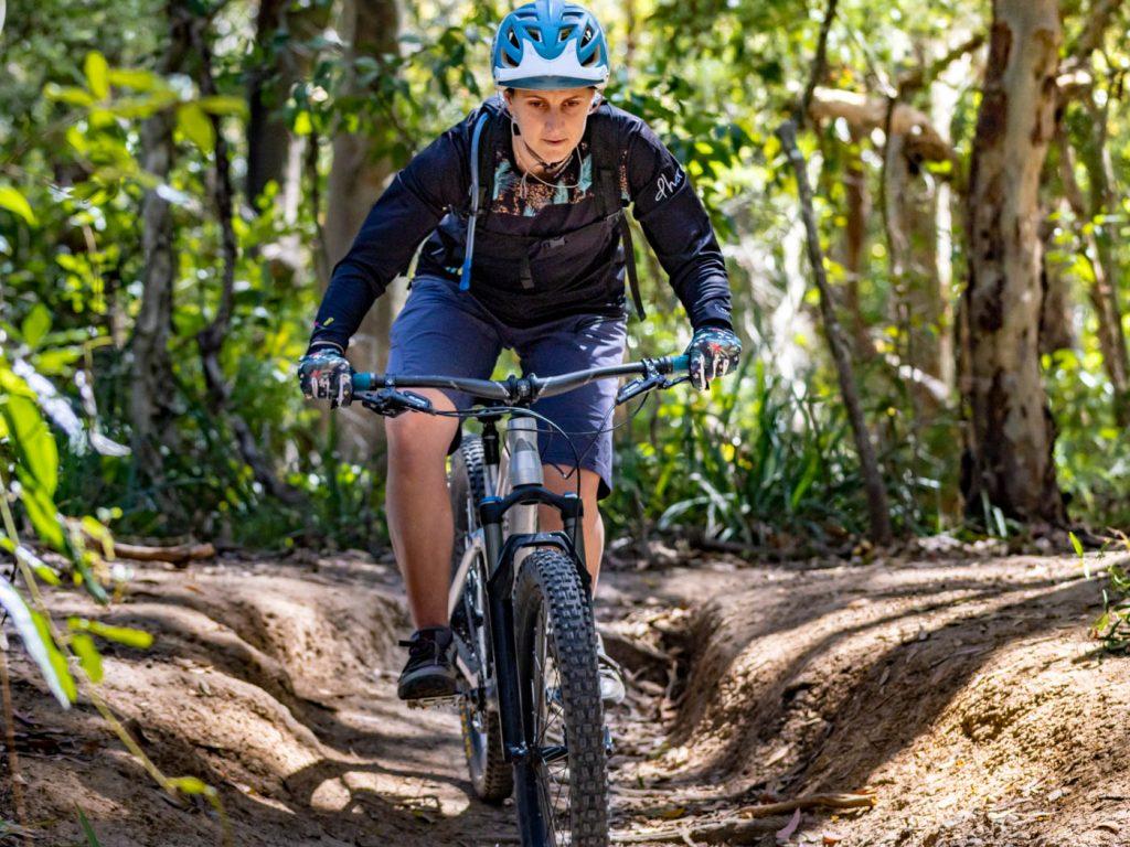 Mountain biking girl go over mu