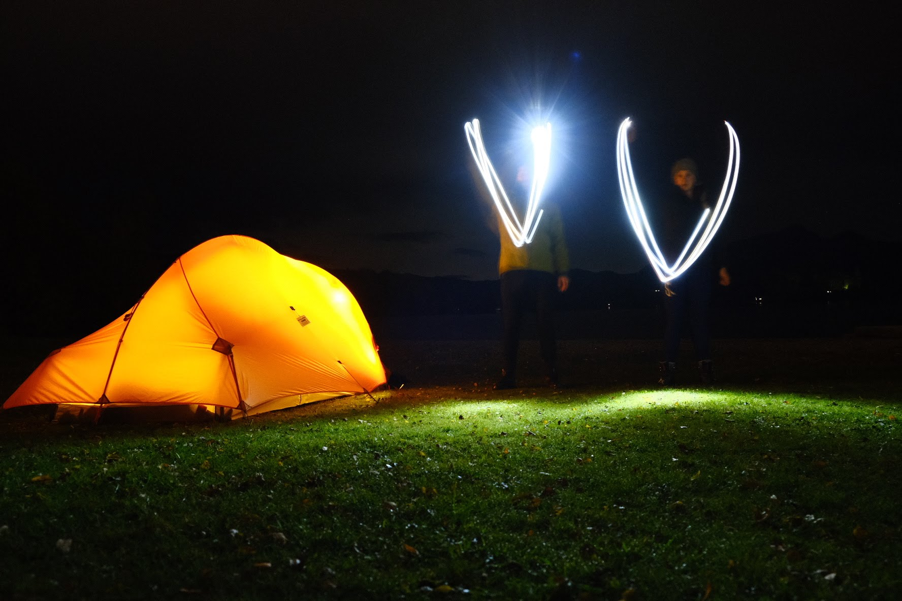Long exposure photo of couple with tent