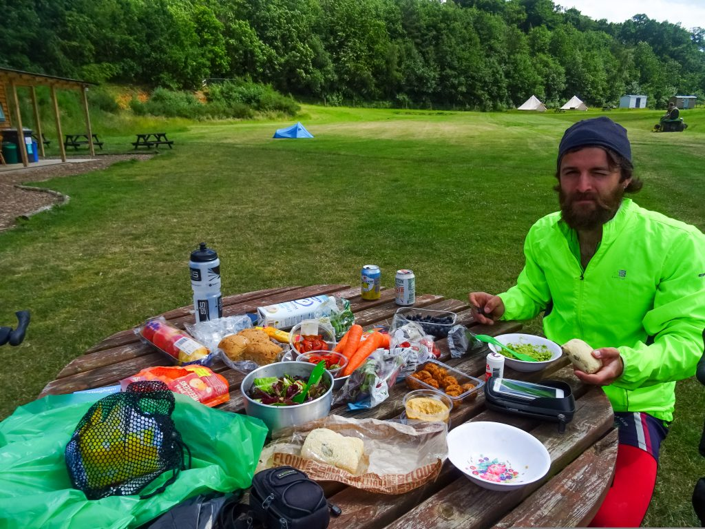Cycle tourer having picnic in park