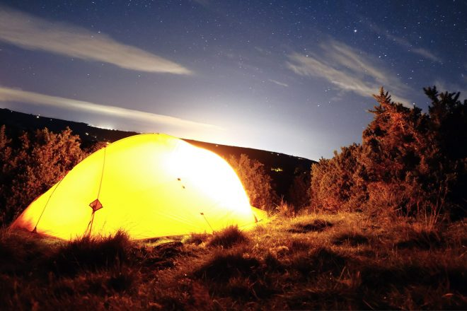 A 2 person tent at night