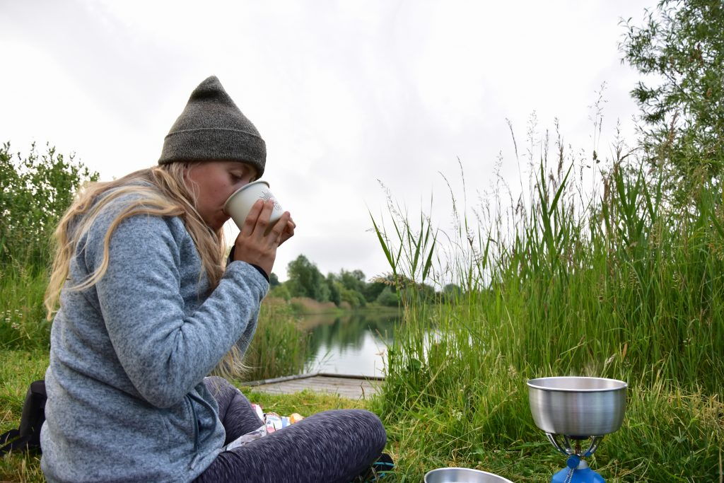 Girl wild camping on cycle tour