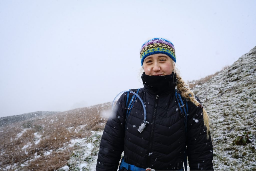 Girl hiking in the snow