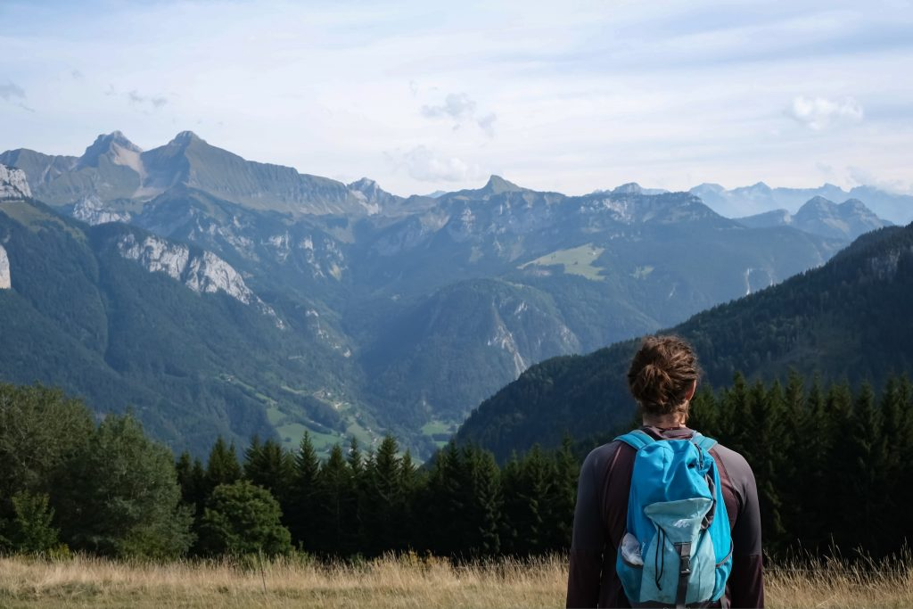 Man on a hiking trail in the French Alps