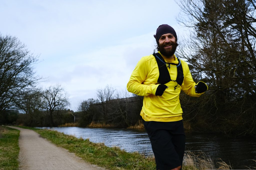 Man running along a canal path