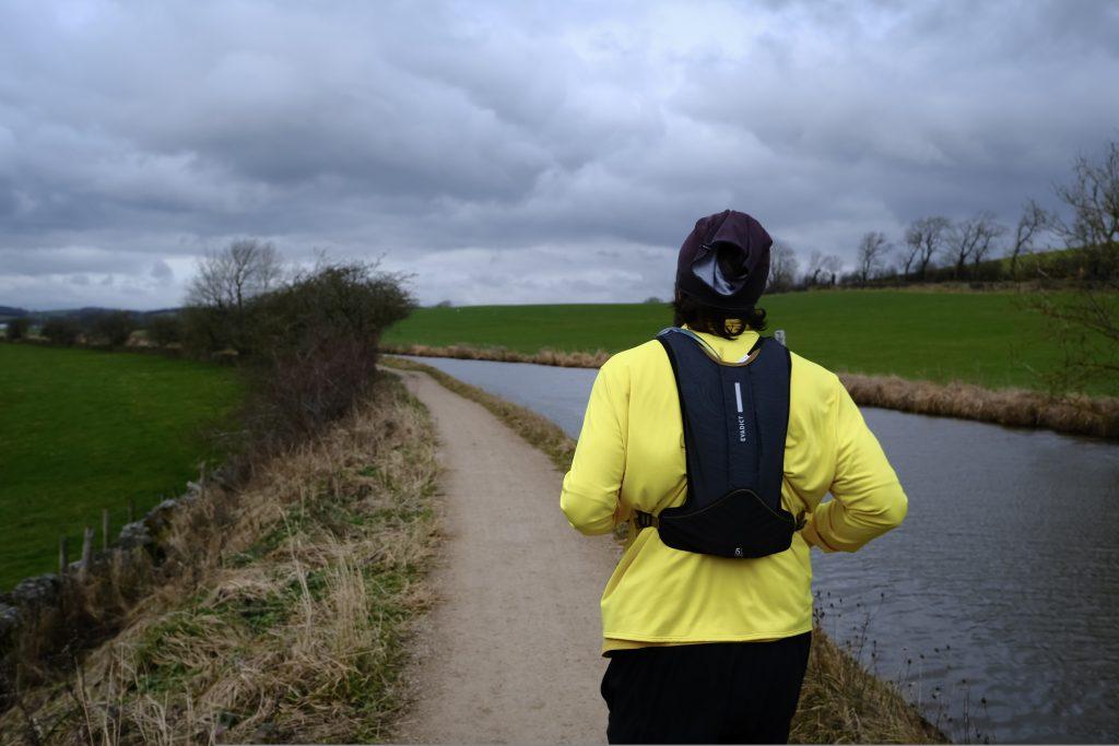Man running along canal