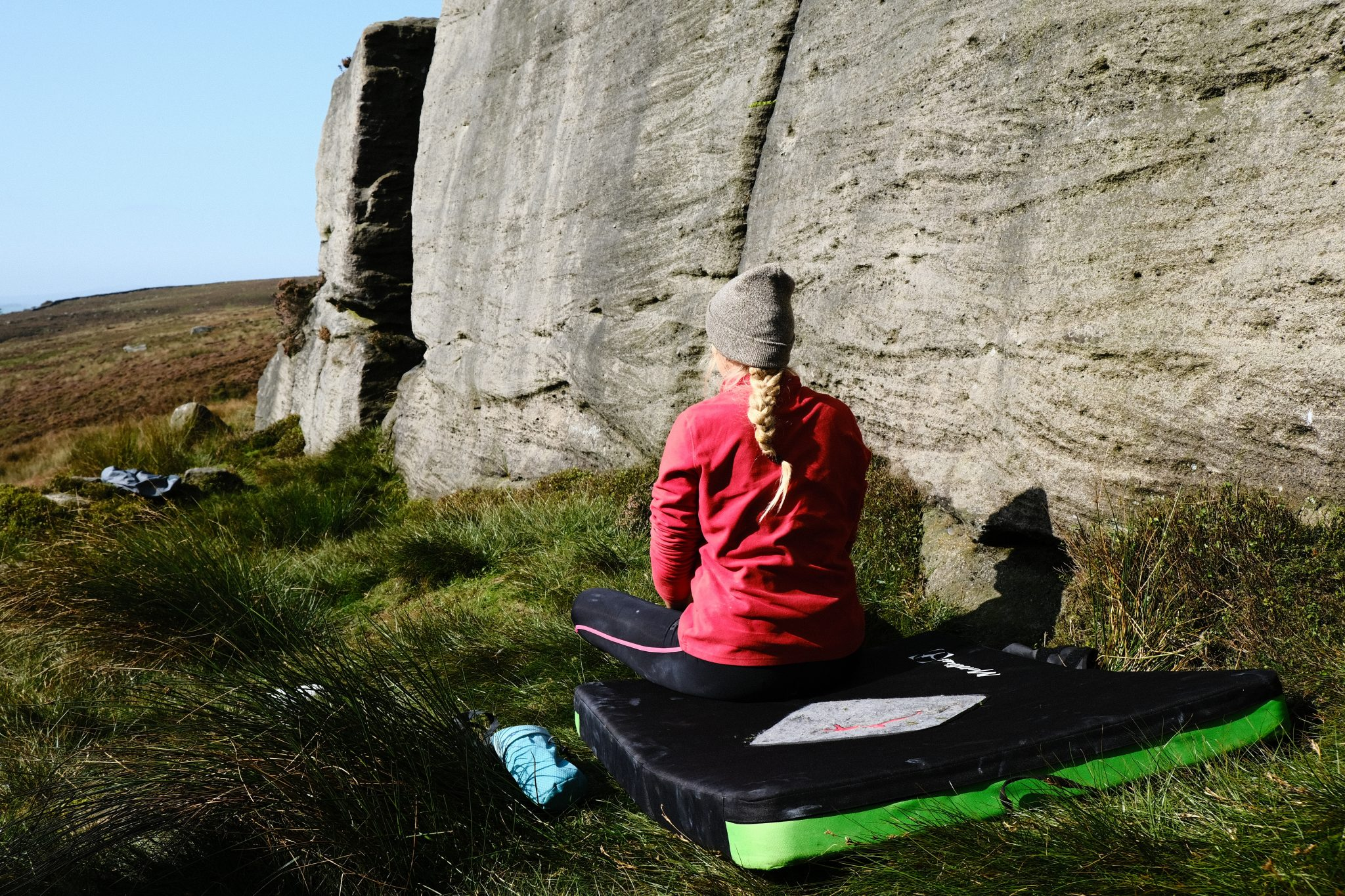 Climber sitting on a climbing pad