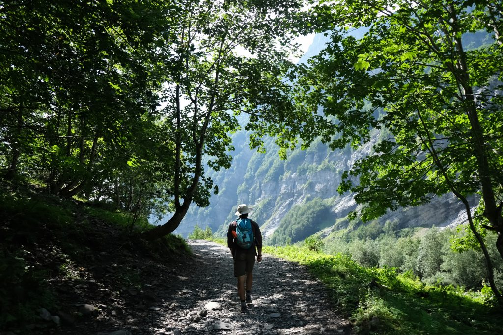 Man hiking through the French Alps