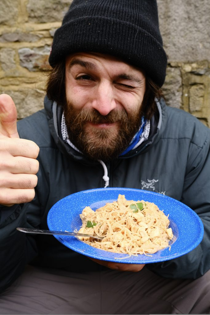 Man eating vegan adventure food