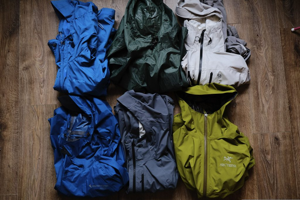 A selection of rain jackets on the floor