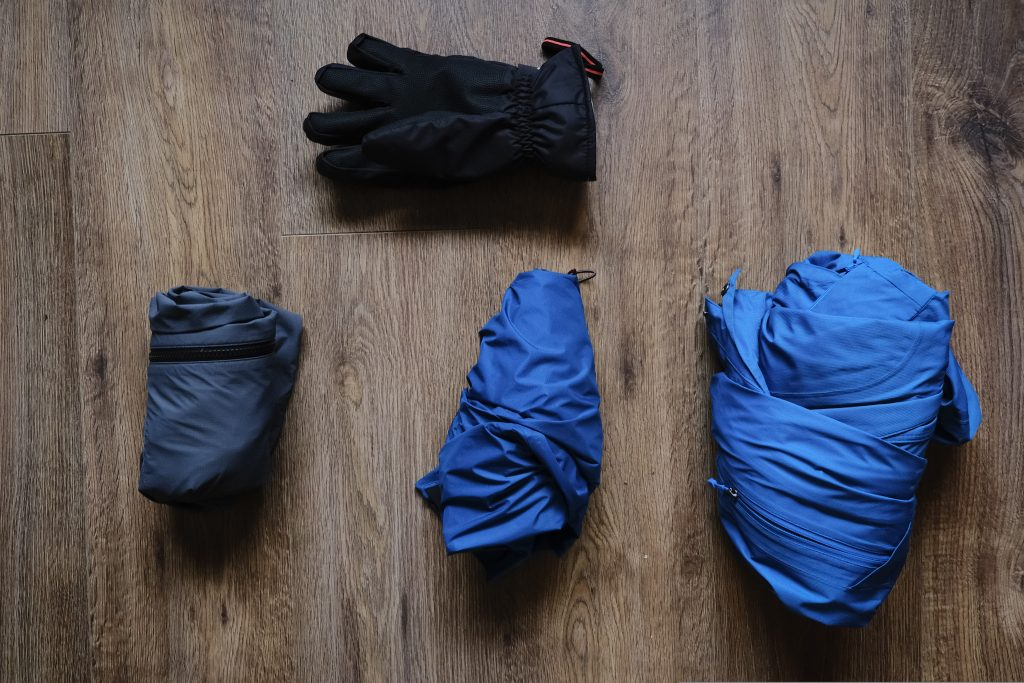 Compressed rain jackets