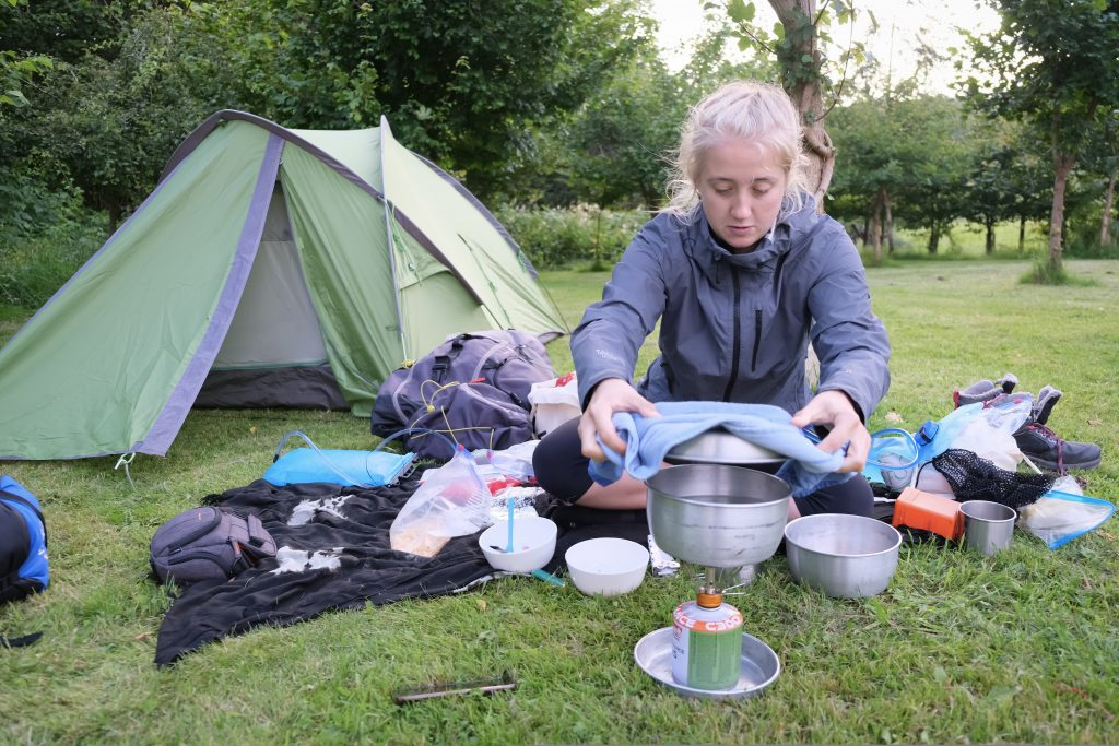 Girl cooking a vegan backpacking meal