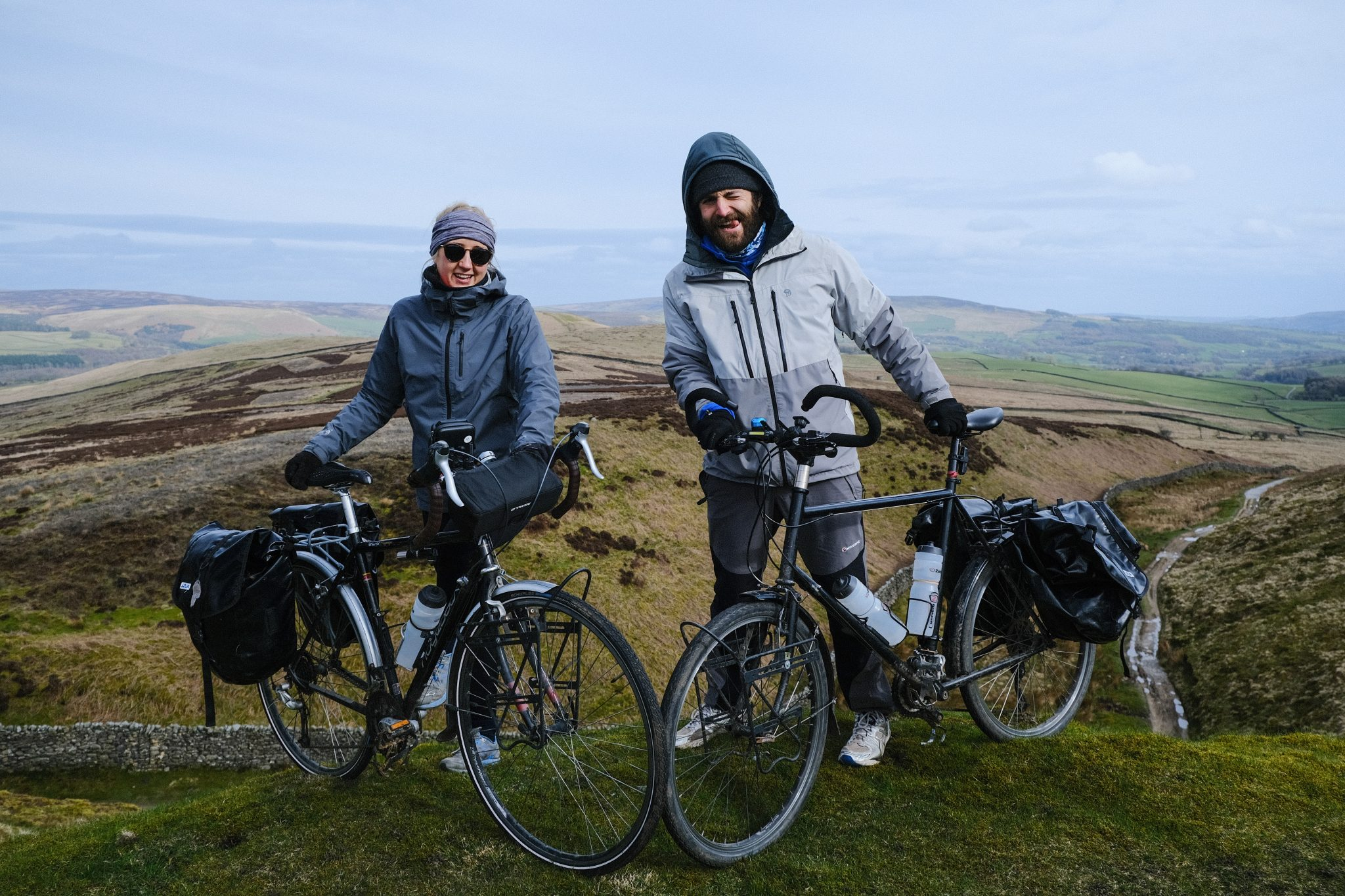 Two cycle tourers in the hills