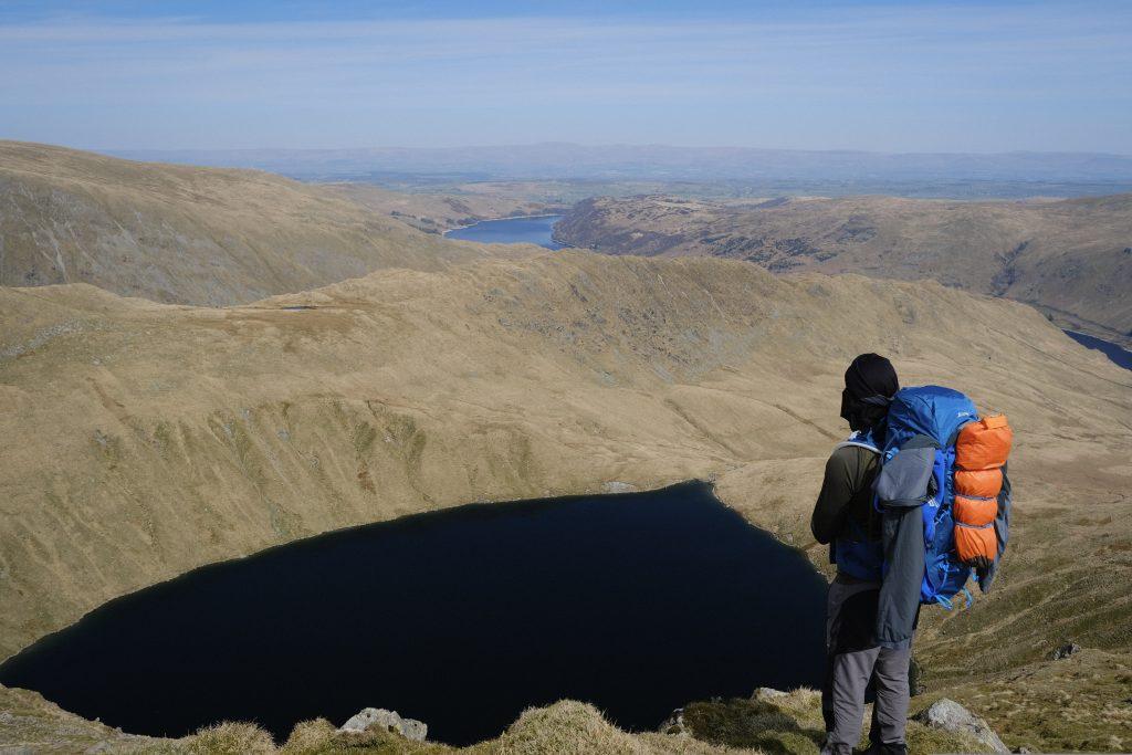 Backpacker overlooking alpine lake
