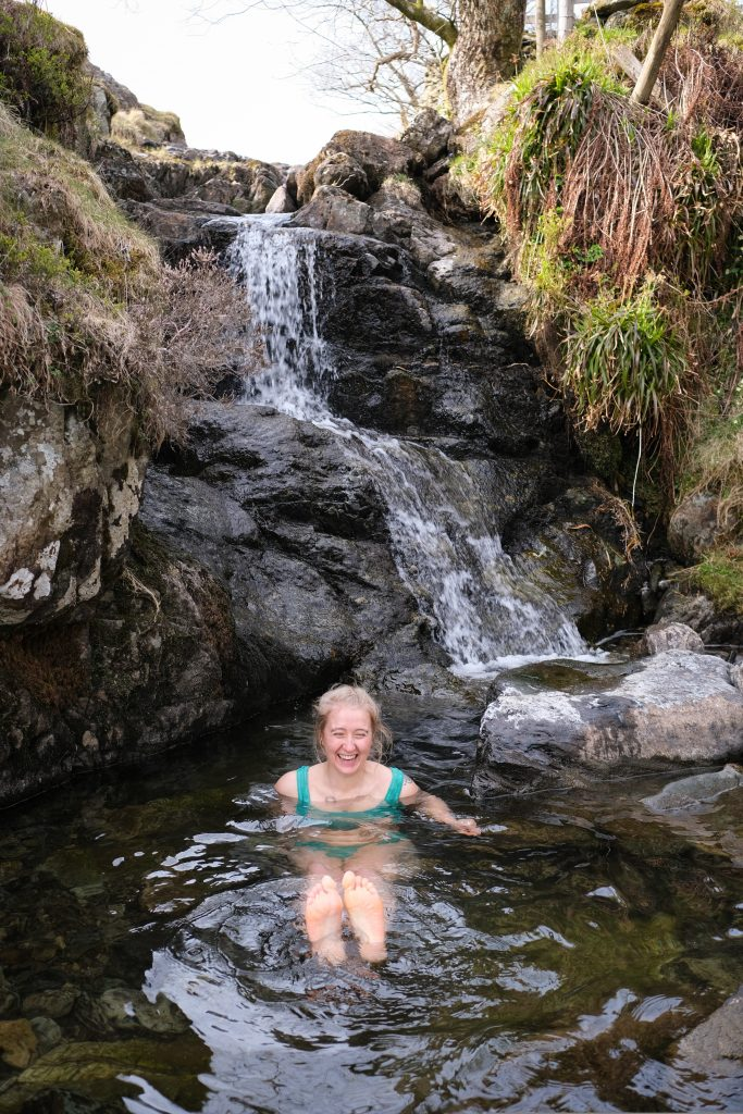Girl wild swimming in the lake district