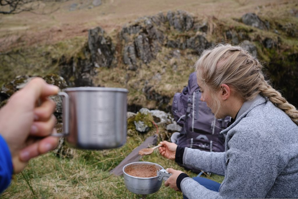 Girl eating vegan freeze dried food