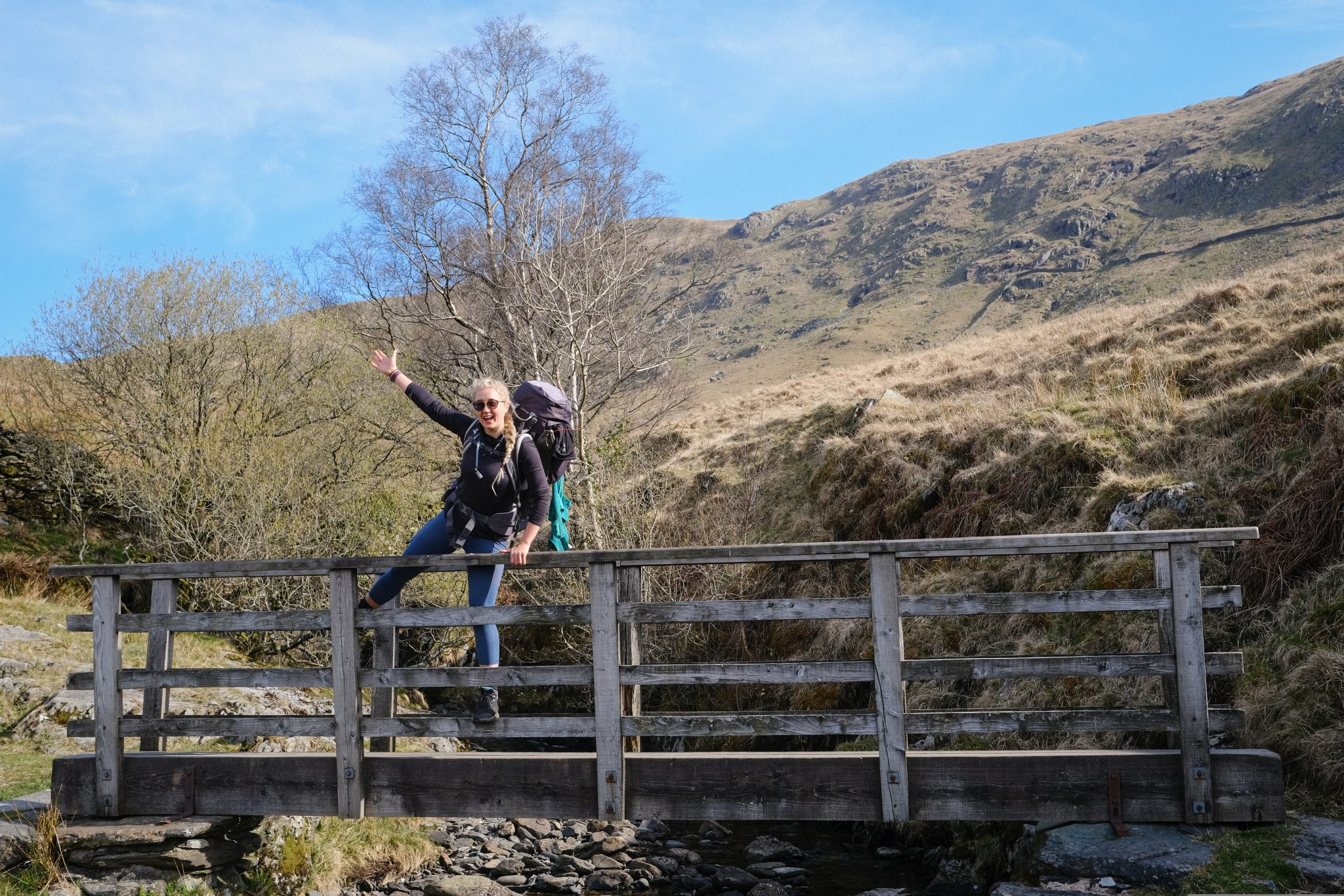 Girl hiking along a bridge