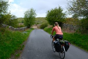 Girl cycling in the lake district national park