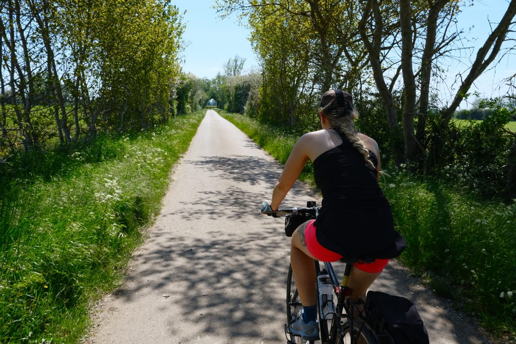 Girl cycling in hot weather